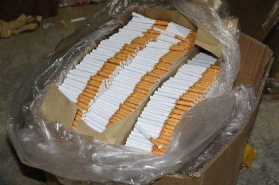 团伙猪圈旁产假烟:每天1万条1秒钟产1盒 涉案1.4亿